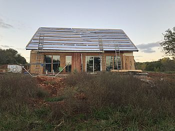 Passive solar home with under floor heat storage