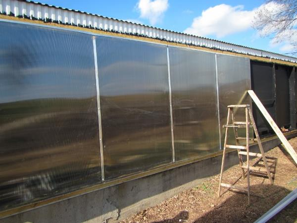 solar collector glazing being installed