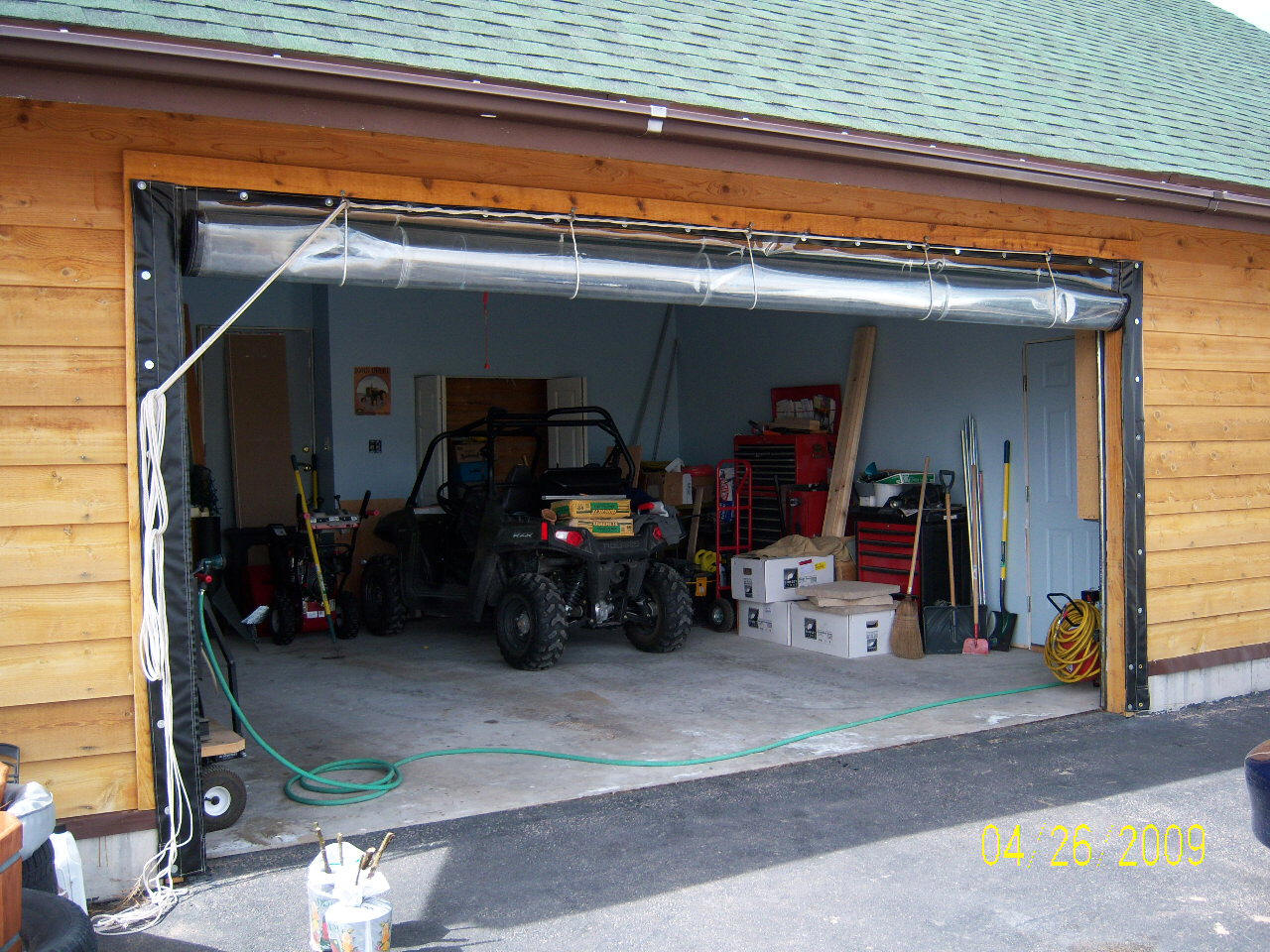 Solar Heated Shop Garage Using Vinyl Curtain